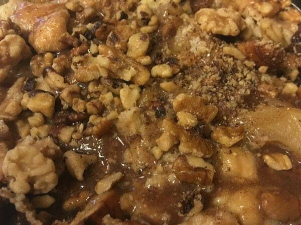 If you like indulgent comfort food in the fall season, then you will LOVE this warm & toasty apple pie bread pudding recipe!
