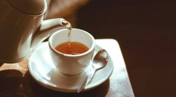 Pouring Tea Into a Cup | 3 Simple Soothing Sore Throat Tea Recipes | Faithful Farmwife