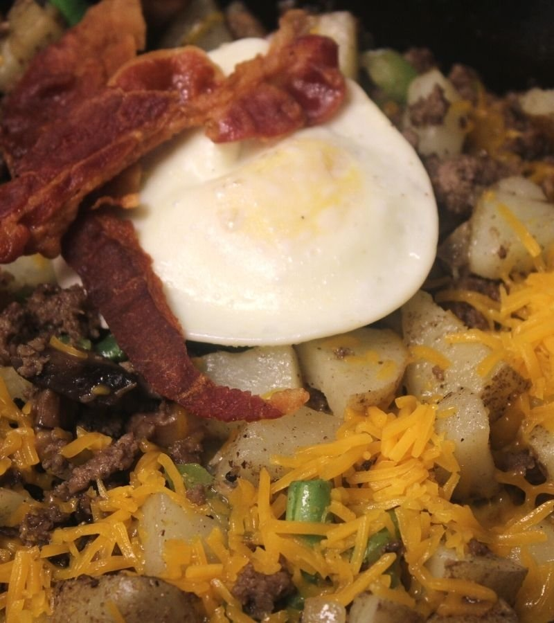 Breakfast Hash with Egg & Bacon on top | Mama on the Homestead