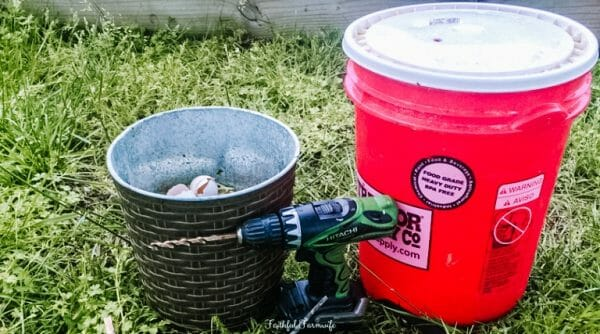 Red 5 Gallon Bucket with white lid, green drill, brown trash can filled with compost | DIY Compost Bin with a 5 Gallon Bucket | Mama on the Homestead