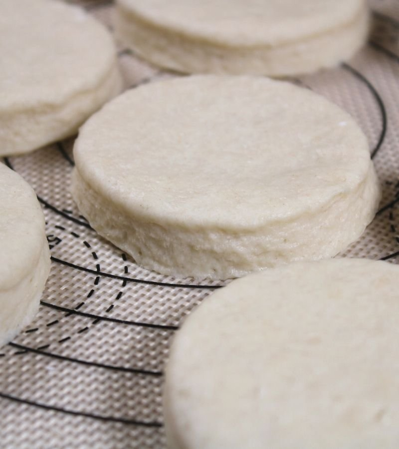 Cut biscuit dough on non-stick baking mat