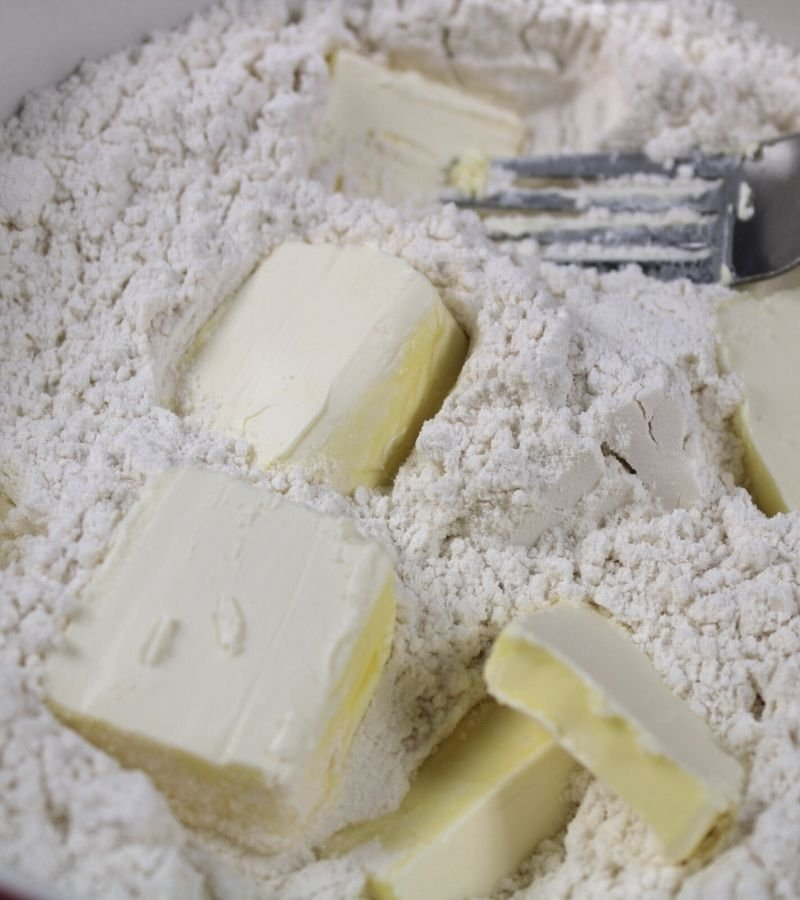 Diced butter in flour mixture for cutting in   Fluffy Homemade Biscuit Recipe   Mama on the Homestead
