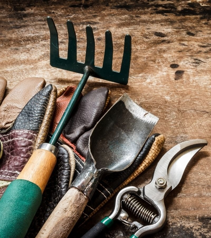 Garden tools laying on a wooden bench | Homestead Mom gift ideas |  Mama on the Homestead