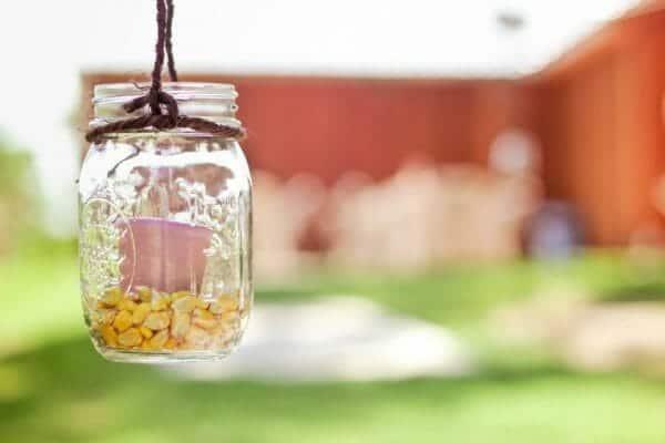 Mason Jar Candle holder | 30+ of the Best Mason Jar Uses for Your Home | Faithful Farmwife