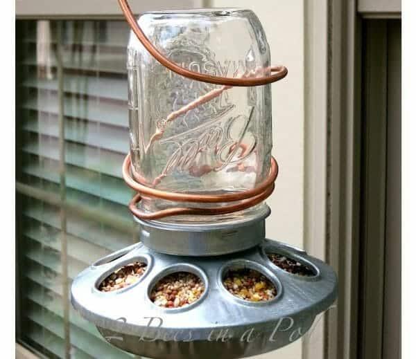 Mason Jar Bird Feeder | 30+ of the Best Mason Jar Uses for Your Home | Faithful Farmwife