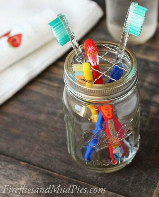 Mason Jar Toothbrush Holder | 30+ of the Best Mason Jar Uses for Your Home | Faithful Farmwife