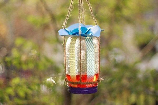 Mason Jar Butterfly Feeder | 30+ of the Best Mason Jar Uses for Your Home | Faithful Farmwife