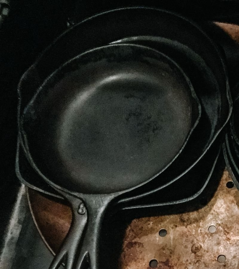Cast iron skillets in a drawer | 30+ Basic Homestead Skills You Need to Learn | Mama on the Homestead