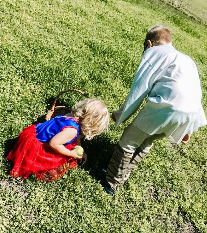 Kids foraging for clover in a backyard | 30+ Basic Homestead Skills You Need to Learn | Mama on the Homestead