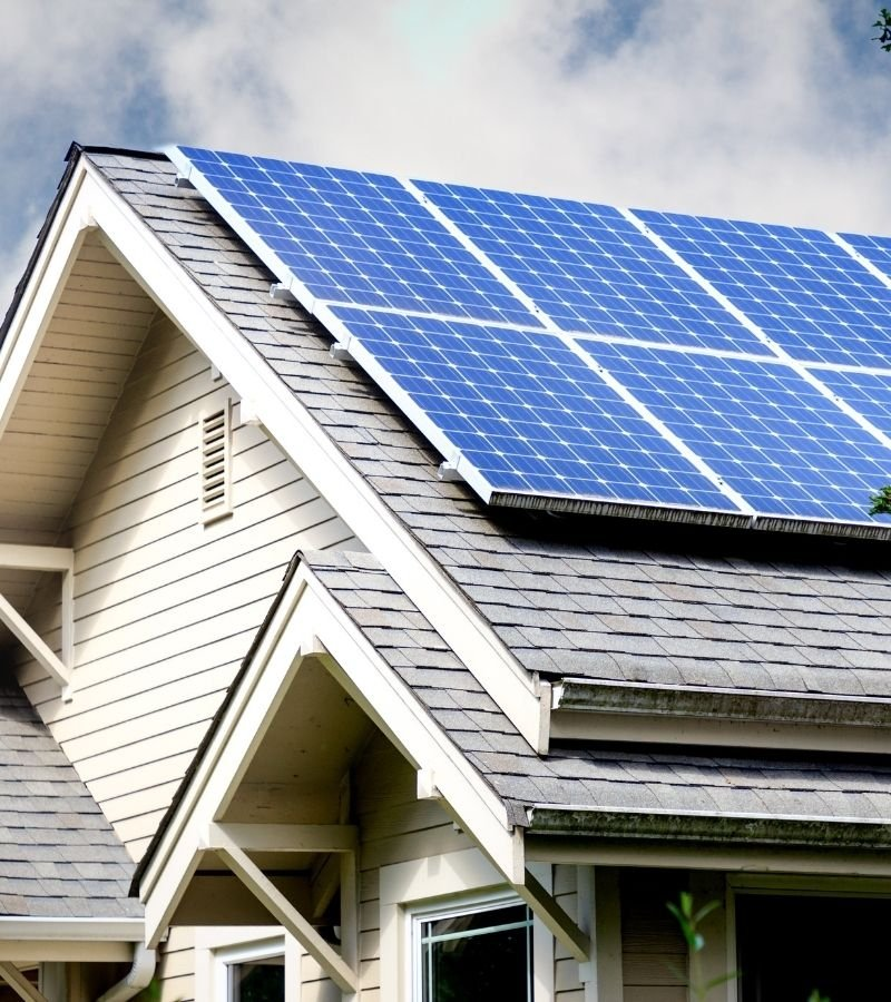 House with solar panels | 30+ Basic Homestead Skills You Need to Learn | Mama on the Homestead