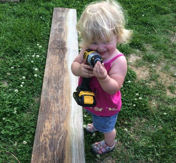 Toddler Playing with Drill | 70+ Practical Homesteading Essentials You Need for Self-Sufficiency | Faithful Farmwife