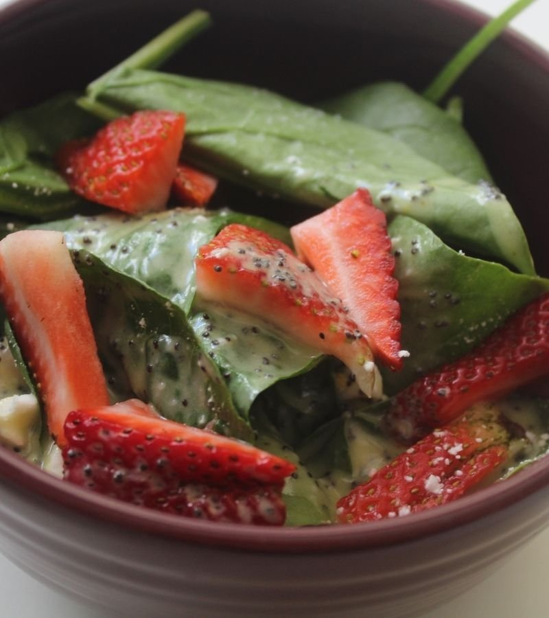 Spinach & Strawberry Salad with poppyseed salad dressing in a purple bowl | Mama on the Homestead
