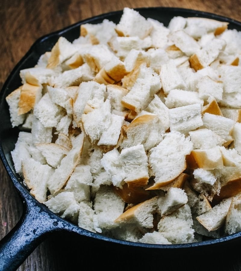 cubed bread in cast iron skillet