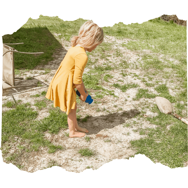 Girl watering a mystery garden |  9 of the Best Gardening Projects for Kids