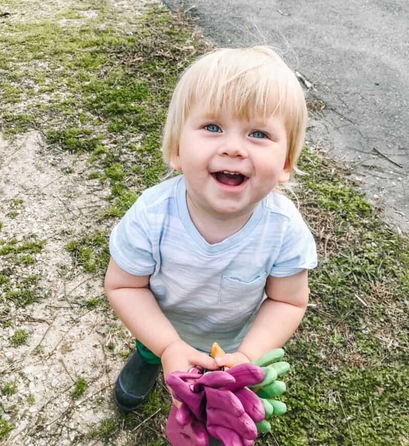 Boy holding kids' garden gloves