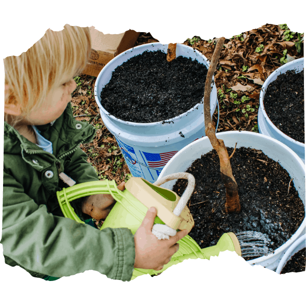 Boy watering plants in a bucket | 9 of the Best Gardening Projects for Kids