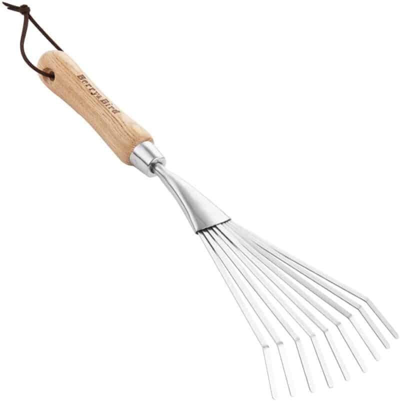 hand held garden rake. wooden handle and metal tines