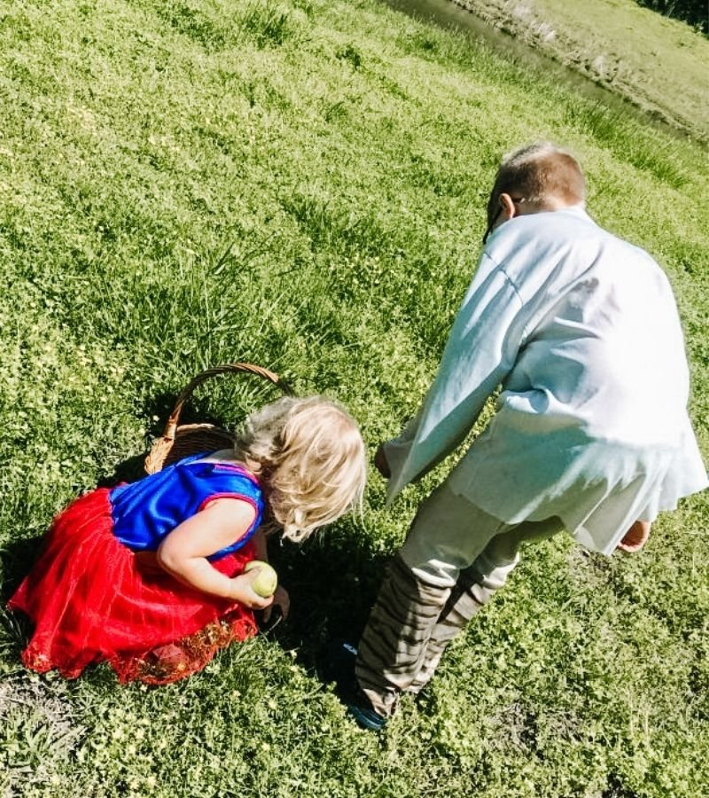 Image of Kids foraging in the backyard | How to Preserve White Clover Blossoms | Mama on the Homestead