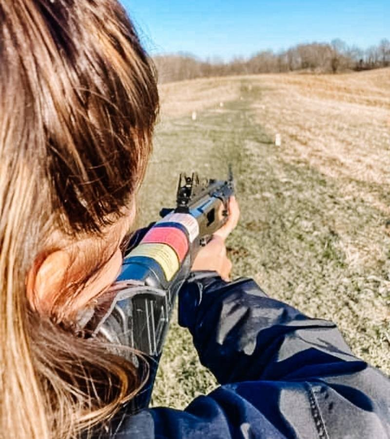 Woman shooting a firearm at a target | Mama on the Homestead