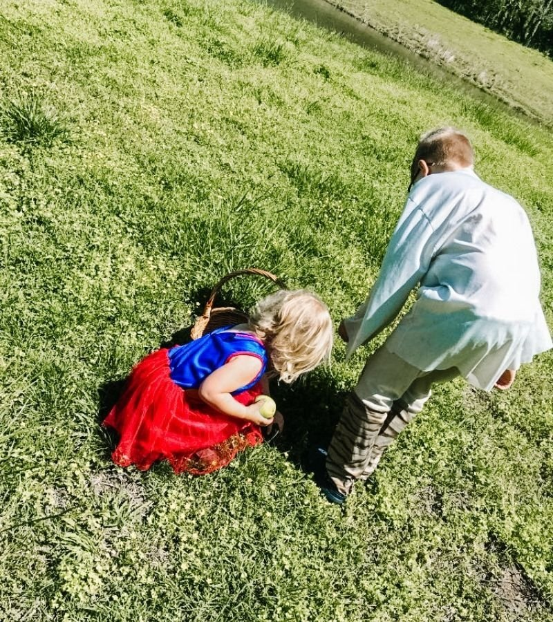 Kids in costumes foraging for white clover | Mama on the Homestead